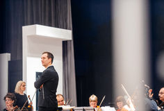 Conductor musicians prepring for orchestra Stock Images