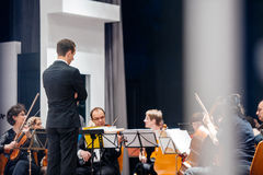 Conductor musicians prepring for orchestra Royalty Free Stock Photos