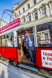 Conductor at old red vintage tram operating in Vienna. Royalty Free Stock Photos