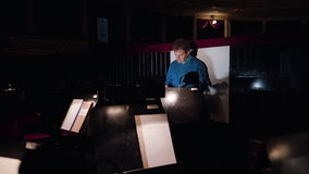 Conductor in an Orchestra Pit Studies Sheet Music stock video