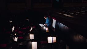 Conductor in an Orchestra Pit Studies Sheet Music stock footage