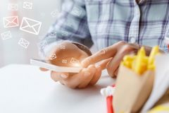 Conducts correspondence on the phone. royalty free stock photography