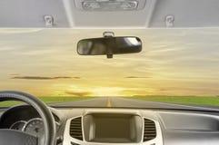 Conduisez au coucher du soleil image stock