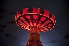 Conduite d'oscillation de carnaval à l'allée centrale images libres de droits