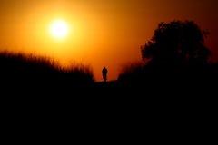 Conduite dans le coucher du soleil Images stock