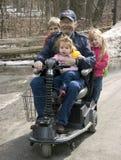 Conduite de fauteuil roulant avec le grand-papa Image libre de droits