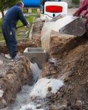 Conduits électriques d'excavatrice couverts Photos libres de droits