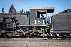 Conduttore sul treno Rio Grande del carbone del Colorado Immagine Stock