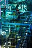 Condutture e scala d'acciaio in una pianta Fotografia Stock