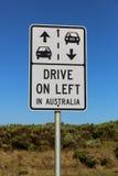 Conduza na esquerda no sinal de Austrália imagens de stock