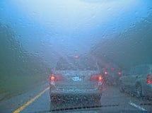Conduzca en lluvia Imágenes de archivo libres de regalías