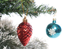Cone. Red cone and blue ball on christmas tree isolated on white Royalty Free Stock Images