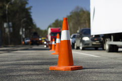Cone barrier repair road. On background traffic Stock Image