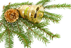 Cone and bell on fir tree branches Stock Photography