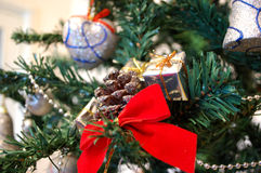 Cone Bow And Present Christmas Tree Decoration Closeup Royalty Free Stock Image