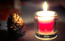 Cone in a candlelight Stock Image