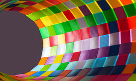 Cone of colorful woven plastic strips Royalty Free Stock Photography