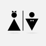 Ícone masculino e fêmea que denota o toalete, toalete Fotos de Stock Royalty Free