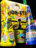 Cone Poppers, Party Poppers and Pop-its. Low Grade hand held fireworks like Pop Its and Party Poppers on a black backdrop stock photos