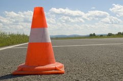 Cone on a road. Warning road mark on a road Royalty Free Stock Photos