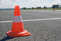 Cone on a road. Warning road mark on a road Royalty Free Stock Image