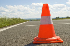 Cone on a road. Warning road mark on a road Royalty Free Stock Images