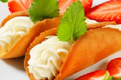 Cone-shaped gingerbread cookies with whipped cream and strawberr Stock Photo