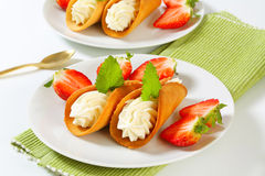 Cone-shaped gingerbread cookies with whipped cream and strawberries Stock Photo