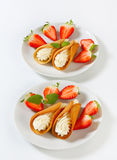 Cone-shaped gingerbread cookies with whipped cream and strawberries Stock Images