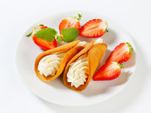 Cone-shaped gingerbread cookies with whipped cream and strawberries Royalty Free Stock Images