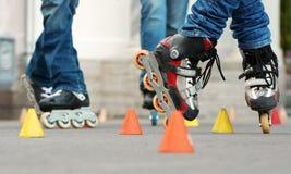 Cone skating (slalom) Stock Image