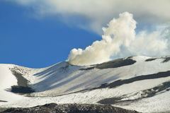 Cone of smoky volcano isluga Stock Photo