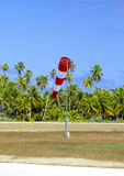 Cone wind measure wind direction in small airfield on the tropical island with palm trees at a runway Stock Photography