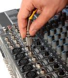Conector de audio y mano Imagenes de archivo
