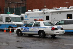 ConEdison Trucks lining NYC after Hurricane. ConEd trucks and NYPD at transformer that blew up during Hurricane Sandy in East Manhattan in NYC stock photo