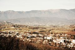 Conegliano Veneto in vintage hues, Italy. Panoramic view to Conegliano Veneto, houses, mountains and colorful buildings, in vintage hues, on Colle di Giano, in stock photos