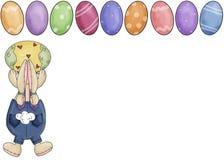 Conejito con el fondo de los huevos de Pascua Fotos de archivo