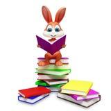 Conejito de Brown pascua con el libro de lectura