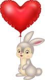 Conejito de la historieta que sostiene los globos rojos del corazón Foto de archivo