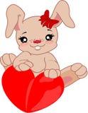 Conejito de pascua con el corazón ilustración del vector