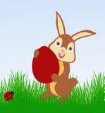 Conejito de pascua con el huevo Imagen de archivo libre de regalías