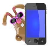 conejito de pascua del chocolate 3d detrás del teléfono elegante Imágenes de archivo libres de regalías