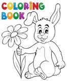 Conejito de pascua del libro de colorear con la flor Imagen de archivo