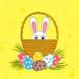 Conejito de pascua en cesta y los huevos de Pascua stock de ilustración