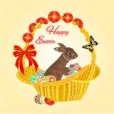 Conejito de pascua en una cesta con vector de los huevos de Pascua Imagen de archivo libre de regalías