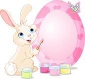 Conejito de pascua que pinta el huevo de Pascua stock de ilustración