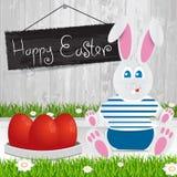 Conejito del este Pascua feliz Huevos de Pascua rojos La hierba con un wo Fotografía de archivo libre de regalías