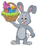 Conejito que lleva a cabo el tema 1 de la cesta de Pascua libre illustration