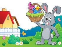 Conejito que lleva a cabo el tema 4 de la cesta de Pascua stock de ilustración
