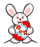Conejito y huevo de Pascua adornado ilustración del vector